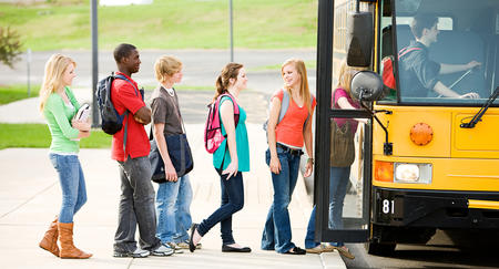 Bild vergrößern: Series with multi-ethnic group of teenage students boarding and on a school bus.  Students boarding the bus.